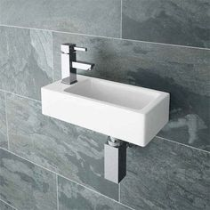 Browse the Rondo Wall Hung Small Cloakroom Basin and add some modern style to your smaller bathroom. Small Cloakroom Basin, Small Basin, Downstairs Cloakroom, Small Bathroom Sinks, Downstairs Toilet, Bathroom Basin, Cloakroom Ideas, Bathroom Ideas, Rental Bathroom