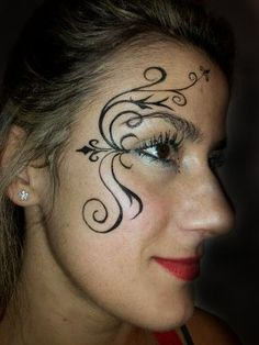 Black and white tribal scroll face painting