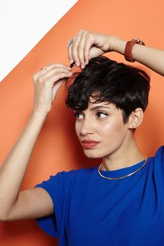 "Hey, Shorty: 4 Rad 'Dos For Pixie Cuts #refinery29  http://www.refinery29.com/55218#slide-4  Now, coax your hair into place with your fingers. ""Remember, there is no part in this style,"" says Brill. ""The front goes straight forward and across the forehead, kind of like a bowl cut."" Finish with hairspray for polish and gloss. Brill blasted Estrada's hair with Kérastase Laque Dentell..."
