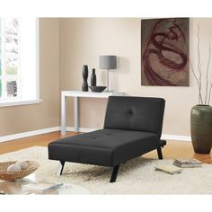 The DHP Wynn Chaise Lounge Futon Sleeper is the perfect addition to any living room. With its tufted faux-leather upholstery and metal legs, this chaise is causal and modern, suitable for any room decor.