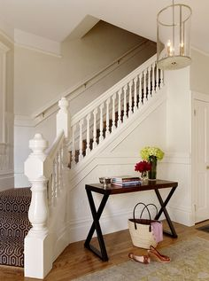 I like the idea of using a graphic patterned carpet/runner for the stairs rather than builder basic carpet or plain wooden treads. This is a happy middle ground.