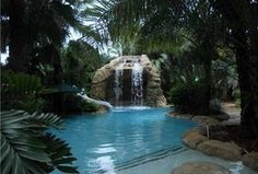 Tropical Swimming Pool with exterior stone floors, Pathway, Raised beds