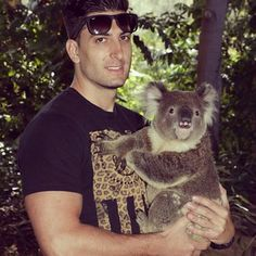 Jesse holding a koala in Australia.