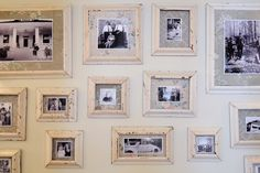 DIY gallery wall made from salvaged wood trim for frames and vintage wallpaper for matting. DIY photo frames