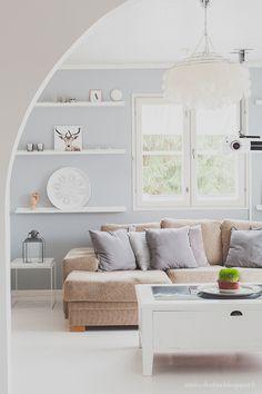 Olohuone / living room.  Wall color: Tikkurila Pro Grey 1966. Ikea ribba shelves.