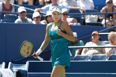 Maria Kirilenko (RUS)[14] in action against Greta Arn (HUN) in the second round of the US Open. - Philip Hall/USTA
