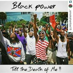 """Fists in the air! Like brother Malcolm says """"By any means necessary!"""""""