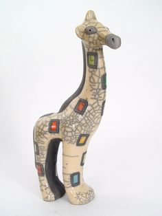 Gazing Giraffe (Large). $62.00. Raku is a collector's quality ceramic art form involving hand molding, hand painting and firing earthenware.  Our pieces pass through the hands of at least eight skilled crafters, making them truly one of a kind.  Given their uniqueness, color may vary slightly on each piece.  Mbare, Ltd. certifies that each piece of Raku Art is handcrafted in Africa and the designs are the originals of our artists. Made in S Africa.