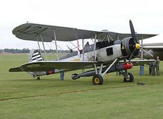 The Fairey Swordfish.  A biplane with fixed landing gear and open cockpit, it is impossible to imagine this crippling the Bismarck or sinking an Italian battleship -- which it did.  It saw work as a torpedo bomber, anti-submarine weapon and reconnaissance aircraft for the Royal Navy in WWII.  The wings were designed for fold back for carrier storage.