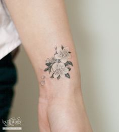 White ink cherry blossom tattoo