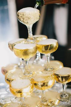 classic #champagne tower | Photography by danieljphotography.com, Design and Planning by http://www.brillianteventplanning.com  Read more - http://www.stylemepretty.com/2013/08/20/private-estate-farm-wedding-from-brilliant-event-planning/