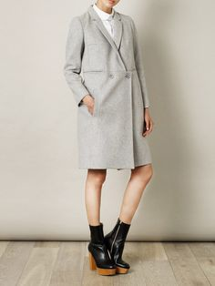 A practical and timeless winter cover-up from Carven, this grey wool coat has a multi-faceted character, enabling it to pair with both formal and dressed-down looks. A feminised take on a classic menswear style, wear it to lend a chic touch of androgyny to your repertoire.