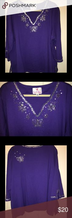 "Quacker Factory 3X Purple Embellished Knit Top This sparkling Quacker Factory 3X cotton knit top is perfect for butterfly lovers (or purple lovers)!  Sequins line the v-neck and sleeves.  A butterfly rests at the bottom of the v-neck and on the back, for a little whimsy!   I only wore this top a couple of times.  Used the machine ""hand wash"" cycle and hung to dry. My home is smoke free, but pet friendly. 🐾  Thanks for looking!  Let me know if you have any questions. Quacker Factory Tops…"