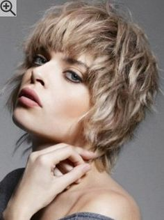 Carefree short hairstyle with wispy tips all around. A wash and go cut that is very easy to style.