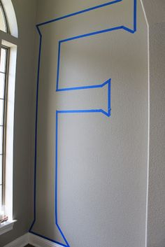 Painting a HUGE letter on your wall.  So awesome.