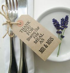 3.75 x 1.75 BROWN KRAFT TAGS THREADED WITH RIBBON OR STRING TO TIE AROUND WEDDING NAPKINS AND SILVERWARE - OR TO WEDDING FAVORS OR CHAIR BACKS. HANDPRINTED - THANK YOU FOR SHARING OUR FIRST MEAL AS MR & MRS. AN EXTRA TO GIVE A PERSONAL MESSAGE TO YOUR GUESTS THESE SIMPLE RUSTIC VINTAGE STYLE TAGS ARE IDEAL IF YOURE LOOKING FOR SOMETHING UNIQUE AND DIFFERENT FOR YOUR RECEPTION TABLES. A GREAT ALTERNATIVE TO TRADITIONAL WEDDING NAPKIN HOLDERS AND SILVERWARE HOLDERS - THEY LOOK STUNNING WHEN…