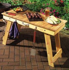 DIY Foldable BBQ Table I think I could even get a lot of the lumber for it from old pallets, so it would be really cheap to make as well!