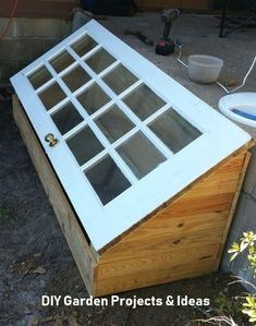 A green house made using a old door. ~ DIY greenhouse A green house made using a old door. ~ DIY greenhouse This image has get 136 Diy Mini Greenhouse, Diy Greenhouse Plans, Greenhouse Gardening, Container Gardening, Greenhouse Wedding, Greenhouse Shelves, Diy Garden Furniture, Diy Garden Decor, Furniture Ideas