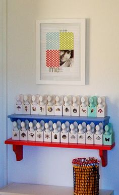 I want my punches displayed like this! I like the framed layout, too (from Mou Saha on her blog) #scrap room