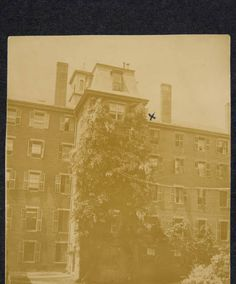 """Mount Holyoke Seminary, main building, exterior, rear view showing courtyard and wisteria-covered bathroom tower; the """"x"""" indicates room occupied by Florence Purington '86 and Julia Kimball '86, with Mary Crowell '89, in 1885-1886 :: Archives & Special Collections Digital Images"""