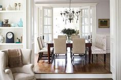 A simple dining room connects the living and family rooms through wide doorways - Traditional Home® / Photo: Michael Garland / Design: Mark Williams