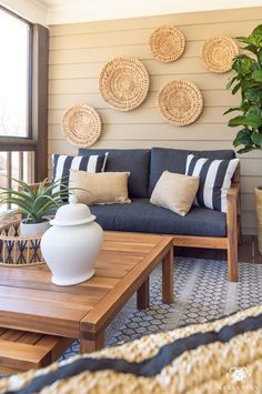Outdoor Living and Cozy Decorating Ideas with wooden outdoor furniture, basket decor for the wall, and neutral accents. Outdoor Living Furniture, Diy Furniture Couch, Furniture Ideas, Pallet Furniture, Screened Porch Furniture, Antique Furniture, Geek Furniture, Outdoor Living Rooms, Coaster Furniture