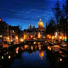 Amsterdam at night, canal reflections