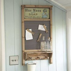 No source, but I love this idea!  A memo board from an old washboard.  Look at the clothespin magnets!