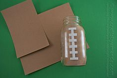 Mason jar Football Centerpiece by Amanda Formaro of Crafts by Amanda (mason jar centerpieces) Football Centerpieces, Football Party Decorations, Banquet Centerpieces, Football Themes, Mason Jar Centerpieces, Mason Jars, Football Decor, Quince Decorations, Banquet Decorations