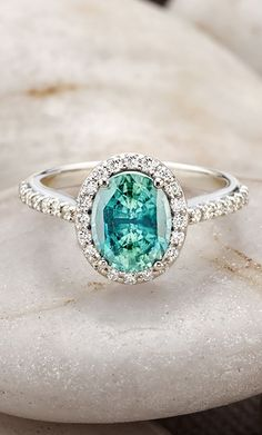 Aquamarine,  but cushion cut, with no halo. Ok babe?