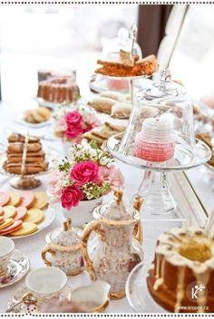 Dessert table, pink flower arrangements