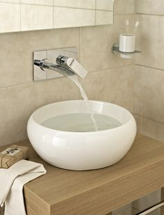 City wash bowl - £139 http://www.bathstore.com/products/city-wash-bowl-2236.html  OpenWater wall mounted two hole basin set http://www.bathstore.com/products/openwater-wall-mounted-2-hole-basin-set-1919.html
