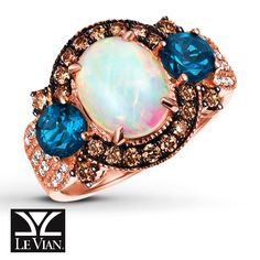 The fiery glow of an oval Neopolitan Opal™ encircled with rich Chocolate Diamonds®and accented on either side by an oval Deep Sea Blue Topaz™ gives this elegant ring from Le Vian® its fascinating center. Sparkling Vanilla Diamonds® adorn the 14K Strawberry Gold® band, bringing the total diamond weight to 5/8 carat. Le Vian®. Discover the Legend. Diamond Total Carat Weight may range from .58 - .68 carats.  Most natural gemstones pictured have be...
