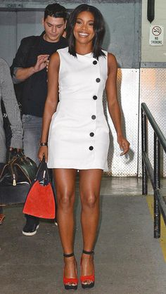 Gabrielle Union in a button LWD and black-and-red accessories