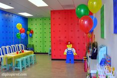 I hosted a Lego themed birthday party for my nephew at my business. I bought plastic table covers from the $0.99 store and stapled them onto the walls, using a different color for each wall. I then printed the Lego logos on colored construction paper that matched the walls. Using a circle cutter, which you can get at any crafts store, I cut the logos into circles. Trust me, the circle cutter will be an invaluable investment for this project.
