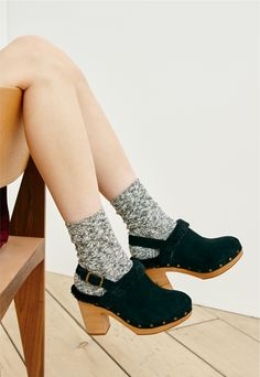 madewell lesley shearling clog worn with the cableknit trouser socks.