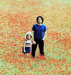 photo of Paul & Heather by Linda - wow, look at Paul's curly/poofy hair!, love the poppy field