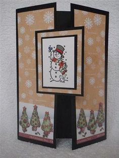Tri fold Christmas Card - bottom half of cardstock, Christmas paper over front flaps, double square frame, stamped with Christmas scene