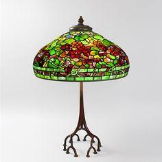 Antique tiffany lamps with art nouveau details.