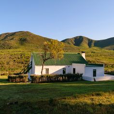 The Windheuevel Farm is in the spectacular Flower Valley of the Western Cape and is the ultimate farm holiday spot for tired souls.  #cottage #mountains #westerncape #farmcottages #farmlife #southafrica