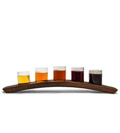 Portland Reclaimed Wood Beer Flight Holder & 5 Glasses by bambeco on Scoutmob Shoppe. For all your home tasting needs: five 7 oz. glasses are nestled into this curved holder, which is made from a reclaimed wine barrel slat.