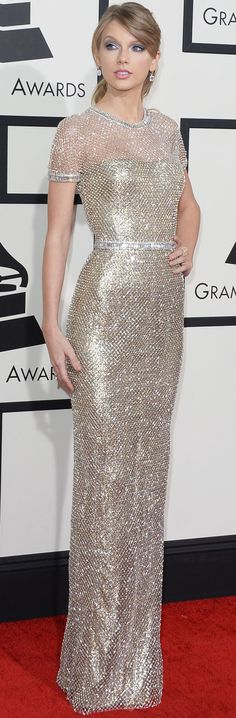 Taylor Swift in a golden Gucci gown at the Grammy Awards