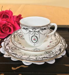 A delicate vintage Shelley Late Foley trio - over 100 years old! A black border of scrolls, circles and small pink rose buds on a white ground. Gold edges. Has a nice Victorian look! Pattern 8414, New York cup shape. Bone China – c. 1911-1916. Good to fair vintage condition – no