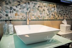 Simply Stunning Spaces bathroom design. Add character to a bathroom with a fun backsplash. There are tons of DIY's all over Pinterest for backsplashes. They are a simple, cost effective, and unique way to add to your bathroom remodel. For more interior design inspiration visit: www.simplystunningspaces.com