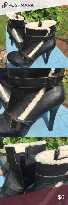 "Mossimo Ankle Boots - Adorable! Size: 9-1/2 Mossimo black, faux leather, ankle boots with faux fur trim. The faux fur trim is accent only (see pics) & does not line the inside of boots. Each boot is accented with two buckles; adjustable. Zip closure; heel is 4"" - measured from top of heel area to bottom of heel cap. Note: Both heels have scrapes/small holes in the faux leather fabric, just above heel caps, as seen in pic 4. (Almost unnoticeable). Heel caps are good & no immed. replacing…"