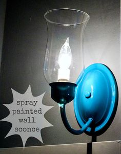 Spray paint your wall sconce for an unexpected pop of color!