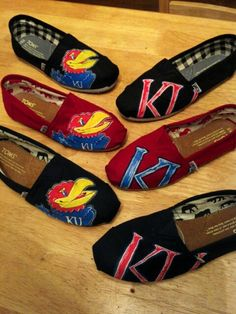 KU TOMS ~ <3  Made in Wichita, KS. Can't find an actual website, but they have a facebook page ~ The BareFeat.  On their fb (The BareFeat) it gives this phone number to place orders for some awesome shoes like these or any other ideas you want put on shoes like these!!!! 316-409-5869