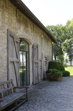 Belgian Style- hmm, surprise it's brick not stone. But stone pitch. Lovely large barn like shutters. French Farmhouse, Modern Farmhouse, Patio Pavé, Cobblestone Patio, Converted Barn, Belgian Style, Stone Houses, Architecture Details, Exterior Design