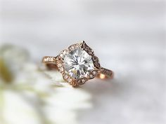 This floral-inspired moissanite ring: | 43 Stunning Rose Gold Engagement Rings That Will Leave You Speechless