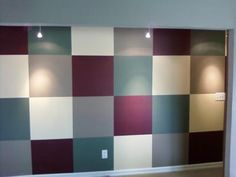 Accent wall with squares painted in different colors:  Here's our unique wall painting idea: a Squared feature wall, which can be seen as soon as you walk through our front door.   Since it was a wall every